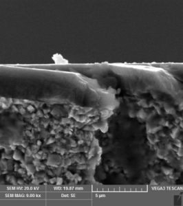 Fracture of cemented carbide with nanocomposite layer (SEM)